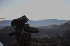 Rock man on hulls. Rock man just chilling near mountains Royalty Free Stock Photo