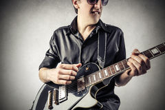 Rock man playing the guitar Royalty Free Stock Photos