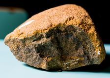 Rock Matrix. Piece of rock matrix, this rock is formed by a layer of iron, the reddish strip at the bottom. This rock, is responsible for forming the soil Stock Photo