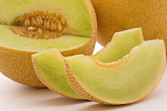 Rock Melon. With 2 slices as closeup on white background royalty free stock photography