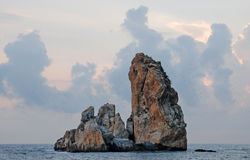 Rock in the middle of the sea Royalty Free Stock Images