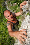 This rock is mine. A climber grips a rock Stock Image