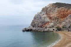 Rock with a mine by the sea. On the Greek coast stock photo