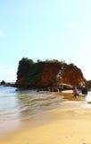 Rock on Mirissa beach Stock Image