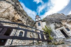 Rock monastery `St. Dimitar Basarbovski` in Basarbovo, Bulgaria. The rock monastery was established during the existence of the Second Bulgarian Empire, but for Royalty Free Stock Photo