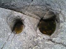 Rock monster eyes Stock Images