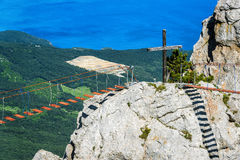 Rock on the Mount Ai-Petri with a rope bridge in Crimea. Russia. It is one of the highest mountains in Crimea and tourist attraction. `Save and Protect` on the stock photo