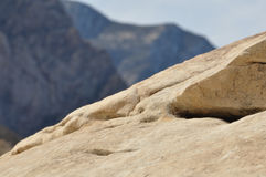 Rock with Mountain in background Royalty Free Stock Images