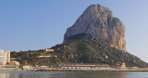 Rock mountain beach of famous spain cozy town calpe 4k. Rock beach panorama of famous spain cozy town calpe 4k spain stock video footage