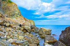 Rock mountain with blue cloudy sky and sea. Crimea, Ukraine Stock Images