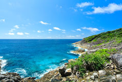 Rock Mountain with Blue Ocean on Blue Sky. At Island Thailand Stock Photography