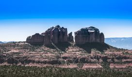 Rock Mountain with a Blue Sky and Green Vegetation in Sedona, Arizona stock photography