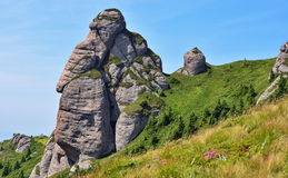 Ciucas Rock Mountains in Romania. Scenic view of Ciucas rock mountains with blue sky, Romania stock photography