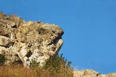 Rock mountain cliff in summer sunny day. Ð¡loudless sky royalty free stock photography