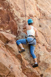 Rock mountain Climber taking climbing leasons Royalty Free Stock Photos