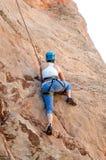 Rock mountain Climber taking climbing leasons Stock Images