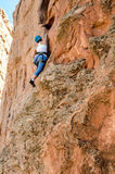 Rock mountain Climber taking climbing leasons Royalty Free Stock Image