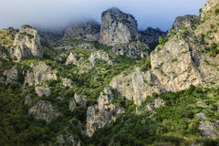 Rock mountain and foggy clouds on top in positano south italy Stock Photos