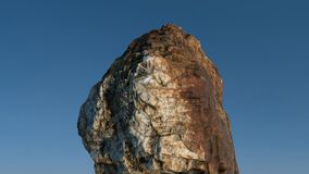 Rock /mountain in front of blue sky. Stock Photos