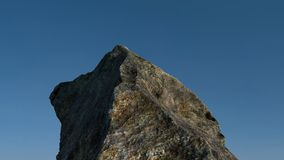 Rock /mountain in front of blue sky. 3D render. Stock Photo