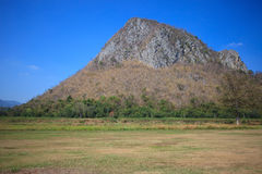 Rock mountain and grass land Royalty Free Stock Photography