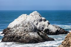 Rock mountain in seashore at Ocean Beach in San Francisco, California. USA royalty free stock images