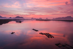 Rock mountain in sunrise time at Phang-Nga bay southern of Thail. Silhouette rock mountain in sunrise time at Phang-Nga bay southern of Thailand. Aerial view Stock Images