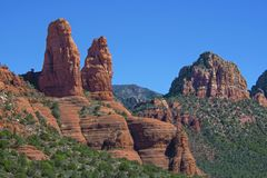 Rock Mountains Formations with Blue Sky and Green Vegetations in Sedona, Arizona stock images