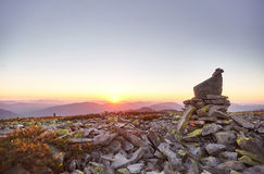 Rock in the mountains. Sunset in the Carpathian mountains. Hill of stones. Ukraine Stock Photography