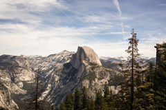 Rock Mountains and Trees Under Stratus Clouds Stock Photography