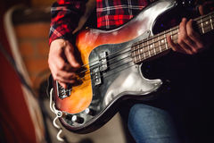 Rock music background, bass guitar player Royalty Free Stock Image