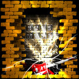Rock music brick wall flash and guitar Stock Photography