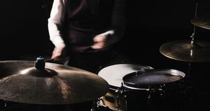 Drummer Plays Drums Kit. Drummer Hand Silhouette With Drumstick. Close up of Drummer Hand Playing Drum Plate on Rock. Rock music concert stage. Musical rock show stock footage