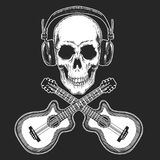 Rock music festival. Cool print for poster, banner, t-shirt. Skull wearing headphones with electric guitar. Heavy metal. Rock music festival. Cool print for Stock Photo