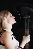 Rock music. Girl musician guitarist with electric guitar. Rock music. Blonde girl guitarist musician performer with electric guitar musical string instrument on Royalty Free Stock Photos