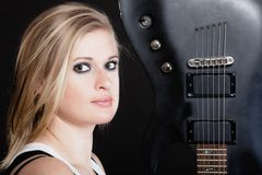 Rock music. Girl musician guitarist with electric guitar. Rock music. Blonde girl guitarist musician performer with electric guitar musical string instrument on Royalty Free Stock Photo