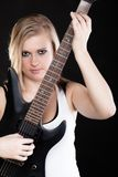 Rock music. Girl musician playing on electric guitar. Rock music. Blonde girl guitarist musician performer playing on electric guitar musical string instrument Stock Photos