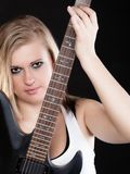 Rock music. Girl musician playing on electric guitar Stock Image