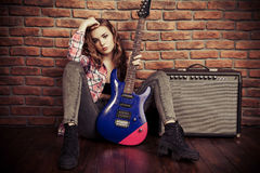 Rock music girl. Portrait of an attractive girl with electric guitar. Rock music Stock Images
