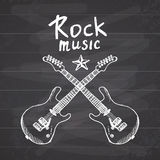 Rock Music Hand drawn sketch crosed guitars, vector illustration on chalkboard Stock Photo