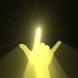 Rock music hand gesture sun light flare Stock Image