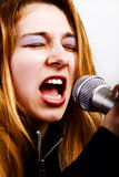 Rock music singer - woman with microphone Royalty Free Stock Photo