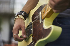 Rock Music Sound. Detail of a Guitarist who plays his electric guitar at a live rock music concert Stock Images