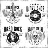 Rock music vector monochrome emblems or labels. Set of four rock music vector emblems, labels, badges or logos in vintage style  on background with removable Royalty Free Stock Photos