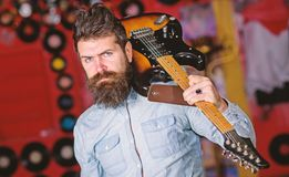 Rock musician concept. Musician with beard play electric guitar. Talented musician, soloist, singer carries guitar in royalty free stock photo