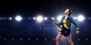 Rock musician at concert Stock Photos