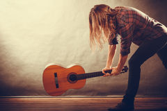 Rock musician destroys his guitar. Rock music energy people feelings concept. Mad rock guitarist destroys his guitar Stock Images