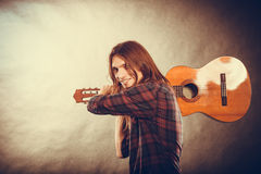 Rock musician destroys his guitar. Rock music energy people feelings concept. Mad rock guitarist destroys his guitar Stock Image