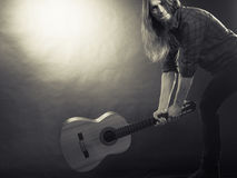 Rock musician destroys his guitar. Royalty Free Stock Images