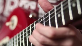 Rock musician with electric guitar fretting chord stock video footage
